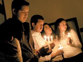 by: Jonathan House, The Diaz family lit candles with dozens of other supporters and friends Wednesday evening during a vigil opposing their deportation next week.