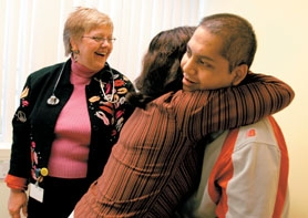 by: Jaime Valdez, Hilda Cueto de Montalvan hugs her son Rony after finding out that his treatment for leukemia is going well as Dr. Janice Olson looks on.