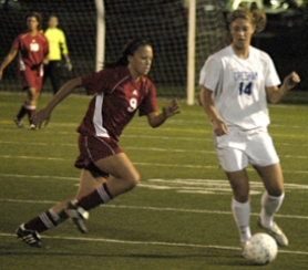 by: David Ball, Gresham's Cori Young, 14, dribbles past David Douglas midfielder Missy Anderson during the Gophers' 2-1 win Thursday night.