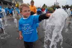 by: Vern Uyetake,  Kendall Beasley and other participants have some fun after all the walkers finished up at the water fountain on State Street.