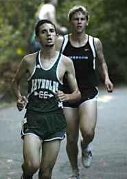 by: David Ball, Reynolds' Karim Shakalia comes down a short hill in front of Gresham's Crismon Lewis during the first mile of Wednesday's cross country race at Laurelhurst Park.