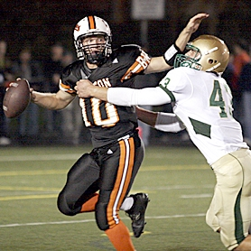 by: MILES VANCE, UNDER PRESSURE — Beaverton quarterback Austin Potter (left) tries to escape from Jesuit defensive end Sean Williams during Jesuit's 52-0 Metro League win at Beaverton High School on Friday night.