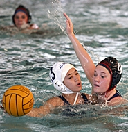 by: MILES VANCE, PRESSURE 'D' — Westview senior Katie Peront (right) pressures Aloha's Lydia Kusnadi during the Wildcats' 12-0 win at Sunset Swim Center on Tuesday.