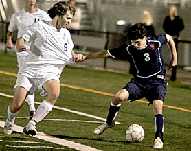 by: JONATHAN HOUSE, SHIRT PULLIN' — Westview's Sean Pullin (right) battles with Sunset's Jared Stensland during the Wildcats' 4-1 Metro League win Monday night.