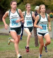 by: DAN BROOD, PACK OF TIGERS — Tigard's, from left, Ellie Bradley, Ali Davis and Cassie Carroll run together at the Jim Danner Invitational, held Saturday at Blue Lake State Park.