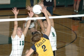 by: Clinton Vining, Estacada's Melita Elliot (12) and Shikara White (9) block Stayton's Madison Clark's attack in Thursday's win in Estacada. The Lady Rangers remain undefeated in the Capital Conference.