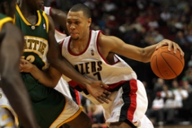 by: Denise FARWELL, In his NBA debut Wednesday, Blazer Brandon Roy fends off Seattle's Damien Wilkins. The Blazers lost 99-89. Their next exhibition is Tuesday at home against Golden State.