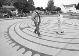 by: Carole Archer, St. Luke's Episcopal Church member Jack Bevilacqua, left, and Interim Church Rector and Rev. Elise Astieford walk the new labyrinth on Tuesday, Oct. 3.