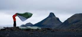 by: ©2006 JONATHAN LEY, David Cobb, half of a recent expedition to hike across Iceland, shakes out his tent in the ever-present wind.