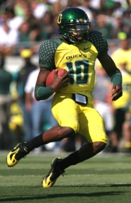 by: DENISE FARWELL, University of Oregon's Dennis Dixon gets carried away – in a good way – against UCLA on Saturday. The Ducks won 30-20.