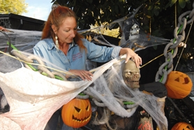 by: VERN UYETAKE, Maria Mattison decorates her Lake Oswego home each year for Halloween. Situated on the corner of Bryant Road and Lakeview Blvd., the home has become a seasonal staple for holiday decorations for the past 12 years. And this year is no different.