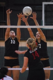 by: Vern Uyetake, Michelle Hurt, left, and Alyssa O'Neal rise up for a block in last Tuesday's 25-19, 25-18, 25-16 victory over Clackamas. The Cavaliers are the second-place team in the Three Rivers League and, with the victory, the Lions virtually clinched yet another league title.