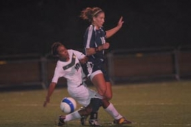 by: Vern Uyetake, Jazmine Whitlock collides with Laker defender Margaret Johnson in last Tuesday's 0-0 tie. The draw keeps the Lions in fifth place in the league, just a few points behind Lakeridge.