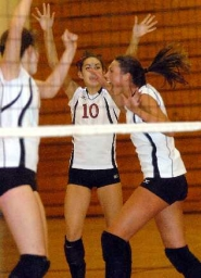by: DAN BROOD, YEAH! -- Ashton Bentz (10) and Sarah Kirsch celebrate during the Wolves' win at Canby.