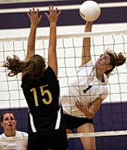by: MILES VANCE, APOLLO ATTACK — Sunset's Laura Stanulis smashes a kill over the attempted block of Southridge's Kelsey Oppat during the Apollos' five-game victory at Sunset High School last Thursday night.