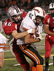 by: MILES VANCE, WRAPPED UP — Westview's Brent Hubbard puts the squeeze on Beaverton's Joel Gross on Friday night.