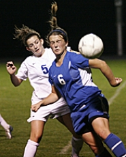 by: MILES VANCE, HEAD GAMES — Valley Catholic's Emily Keagbine heads the ball away from Catlin Gabel's Hannah Carr during the Valiants' 2-1 loss to the Eagles on Monday night.