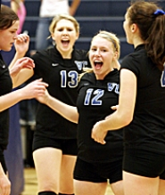 by: MILES VANCE, CELEBRATE — Valley Catholic's Caitlin Rosetti (center) celebrates a point with teammates (from left) Kaly Mueller, Melanie Rosetti and Marybeth Wikander during their win over Colton Tuesday night.