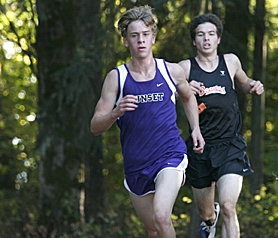 by: MILES VANCE, IN THE WOODS — Sunset's Ryan Kavanaugh leads Beaverton's Paul Fowler out of the woods en route to victory in his team's race against Beaverton while Fowler finished second last week.