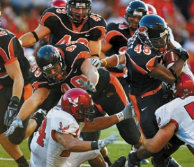 by: L.E. BASKOW, Oregon State linebacker coach Greg Newhouse rotates reserves with starters like Derrick Doggett (45, right).