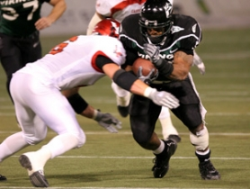 by: DENISE FARWELL, Viking tailback Mu'Ammar Ali powers into Eastern Washington tackler Bryan Jarrett in Portland State's 34-0 victory Saturday. Ali carried 29 times for 160 yards.