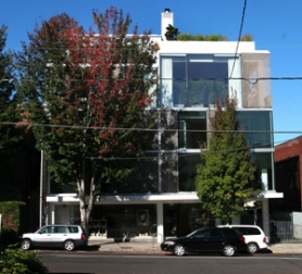 by: JIM CLARK, In a recent poll of Portland architecture's hits and misses, Brad Cloepfil's 2001 concept for a four-story glass cube of a home at 2281 N.W. Glisan St. – also site of a Dosha salon – wins raves for its simplicity.