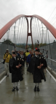 by: patrick sherman, A pair of bagpipers leads a procession of local leaders across the