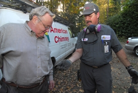 by: Vern Uyetake, Walter Smith from American Chimney and Masonry Inc. shows Lake Oswego homeowner Greg White flammable creosote from the interior of his chimney.