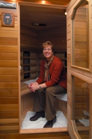 by: Vern Uyetake, Diane Bays takes a time-out to sit in the far infrared sauna within the relaxation room of Healthy Spaces in West Linn. These saunas use far infrared light — part of the invisible light spectrum that makes natural sunlight beneficial and healthy. UV rays are not used as far infrared signals penetrate the skin and reach deep into muscles to raise the temperature, increase circulation and stimulate sweat glands.