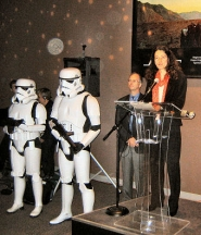 "by: Eric Norberg, OMSI President Nancy Steuber was well-protected when she faced the press at the preview of the ""Star Wars Science"" exhibit at the museum, which opened to the public October 11th. It will be in town through January 1st."