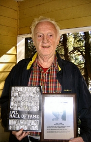 by: Eric Norberg, Sellwood resident Ray Hyde proudly displays the program from this year's PIL Hall Of Fame Induction Banquet (his picture is third from the top at the left side of the cover), and the plaque he received recognizing his induction.