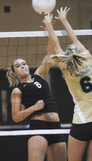 by: Vern Uyetake, Leah Bergstrom follows through for a kill in last Tuesday's quick three-set victory over Lakeridge. Bergstrom played a key role for the Lions who went unbeaten in league and clinched another TRL title.