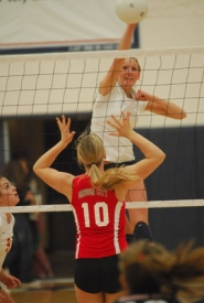 by: Vern Uyetake, Lake Oswego's Anna Gornbein registers a kill during last Thursday's key TRL volleyball match against Oregon City. The Lakers won the match in four sets and then claimed the TRL's No. 4 playoff berth after Oregon City lost to Clackamas on Tuesday.