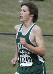 by: David Ball, Reynolds freshman Kevin Wooley makes the final trip around the track during Wednesday's district meet.