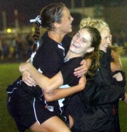 by: DAN BROOD, WE DID IT — Tualatin seniors Rachelle Kliewer (left) and Lindsey Wilcox celebrate following the Timberwolves' 1-0 win over Tigard in the girls soccer showdown.
