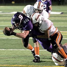 by: JONATHAN HOUSE, APOLLO POWER —Sunset senior running back Kerry Degman dives for a touchdown with the Beaverton defense hanging on him during the Beavers' 34-33 come-from-behind Metro League win Friday night at Beaverton High School.