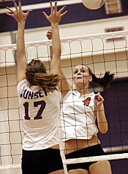 by: MILES VANCE, BEAVER BELIEVER — Beaverton senior Caitlin Fetzer connects over the defense of Sunset sophomore Jennifer Jorgensen during the Apollos' win at Sunset High School last week.