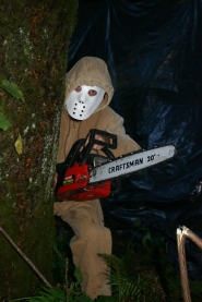 by: Marcus Hathcock, This chainsaw-wielding bogeyman may appear menacing, but it's all in good fun at the Spook Trail.