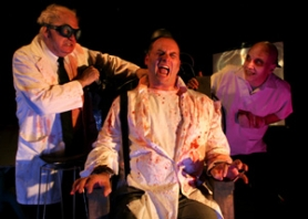 "by: DENISE FARWELL, In Theatre du Grand Guignol's ""Laboratory of Hallucinations,"" players (from left) Brian Jones, Benjamin Carroll and Patrick John apply some suspect science."