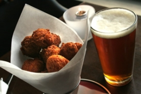 by: ©2006 DAVID PLECHL, Savoy's seasonal appetizer of pumpkin fritters sets off sweet flavor explosions that are well-accompanied by an IPA.