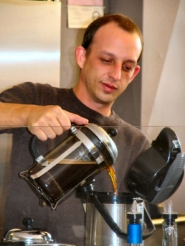 by: Judy Beaudette, Dave Dilley, the owner of the new Caffe Dimora, pouring his brew.