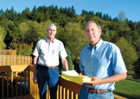 by: Carole Archer, Paul Masulis, left, and Craig Smith stand on Masulis' deck overlooking the 1,000-foot Gabbert Butte. Both men are against clear cutting the butte for the proposed Darby Ridge subdivision.