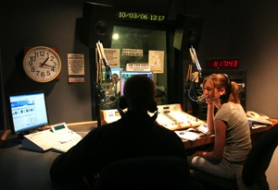by: JIM CLARK, Juniors Jordan Rogers (left) and Lexy Spinisteanu go on the air in their radio broadcasting class at Benson High School. The school's emphasis on technical programs has long been its drawing card.