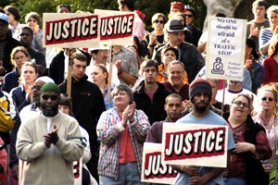 by: TIM JEWETT, In the wake of James Jahar Perez's fatal shooting by police officers after a traffic stop, hundreds of protesters gather in April 2004 to rally downtown. A few months later a new rule went into effect requiring officers to file a report every time they used force. Now the pressure's on to look at the data.