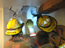 by: patrick sherman, Firefighters pursue a smoldering blaze hidden inside the walls of an Oregon City home.