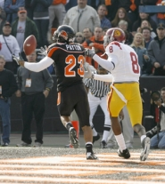 by: TOM HAUCK, Beaver Bryan Payton intercepts a pass Saturday against Southern Cal's Trojans. OSU won 33-31.