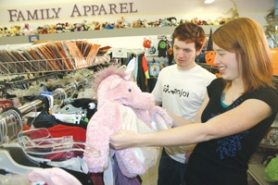 by: Marcus Hathcock, Sarah Bunker, 19, of Gresham, discovers a pink, fuzzy unicorn costume at the Sandy Goodwill store Friday, Oct. 20.