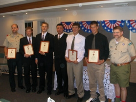 by: Anthony Roberts, From left, Boy Scout leader Orlin Wetzker, scouts Michael Blackham and Scott Adams, Scout leader Bill Butterfield, his son Brian, Derek Kotowski, and Robert McDonald of the award review committee.