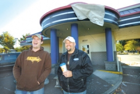 by: Carole Archer, Tommy Mestas, left, assistant manager of the Dutch Bros. Coffee kiosk at Southeast 162nd and Stark Street, and Curt Hugo, owner of Dutch Bros. Coffee, stand in front of the planned second location in Rockwood on Tuesday, Oct. 31.