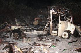 by: Phil Schneider, This is what remains of Donald Paulson's 19-foot RV.